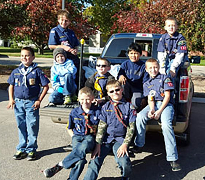 Central City Scouts collect food for Merrick County Food Bank.