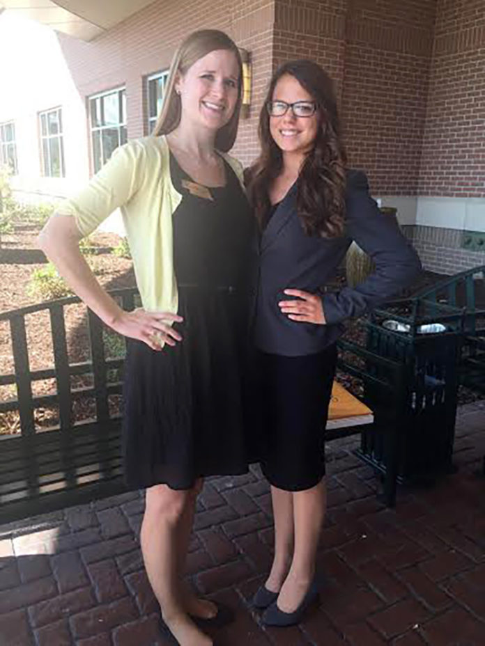 DECA Leadership conferees Central City High School DECA sponsor Brittany McPhillips (left) and DECA member Kiley Bamesberger stop for a photo at the 2015 DECA Leadership Conference in La Vista, NE.