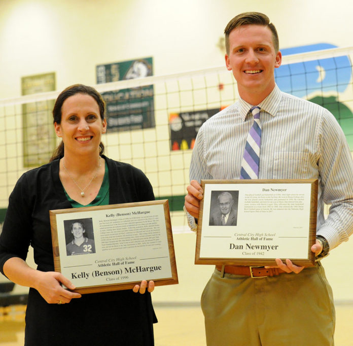 Tuesday night Central City High School honored the two newest members of its hall of fame, including Kelly (Benson) McHargue, formerly a Lady Bison athletic great and a current teacher and coach at the school, and Dan Newmyer, a former Bison athlete and state level game official, who was represented by his son Dan Newmyer. (R-N Photo by Bob Jensen)