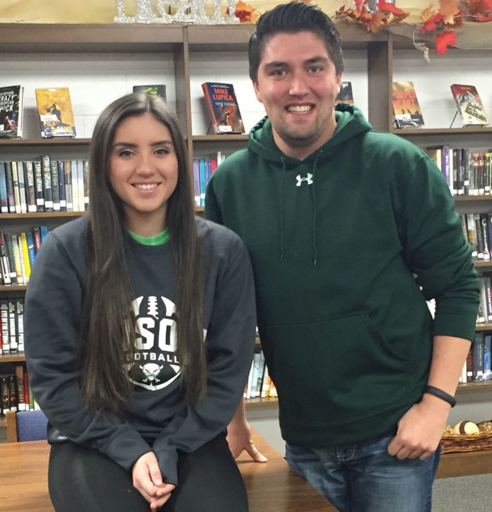 Central City High School 's Katrina Gomez, a senior, is joined by instructor Dane Christensen for a photo ahead of November 21's All-State Chorus public performance.