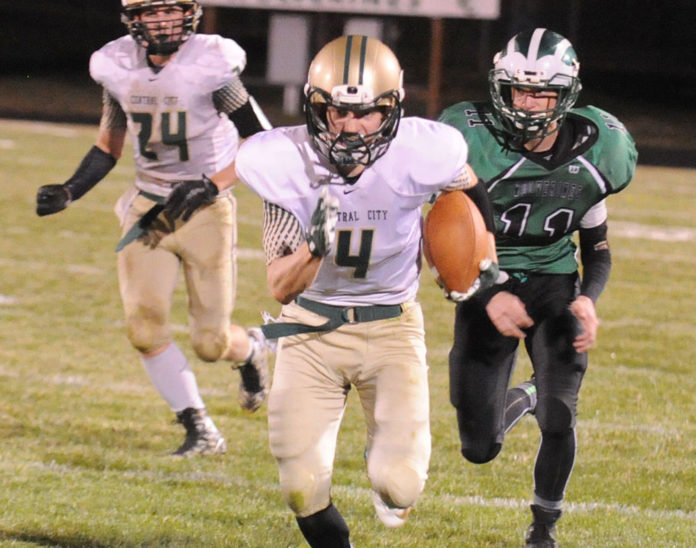 Central City's dream football season came to a close last Friday, as the Bison suffered a 41-34 loss to unbeaten Wilber-Clatonia. Senior Kordell Hamer (4) races upfield after making a catch.